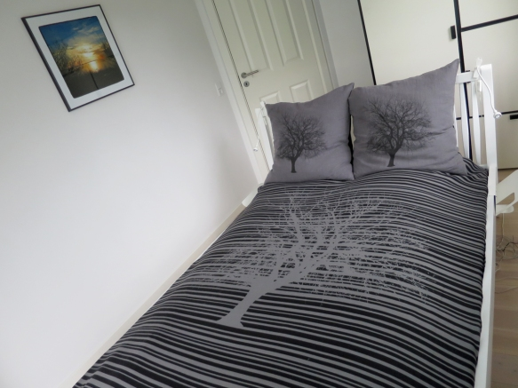 sengetæppe med piletræ